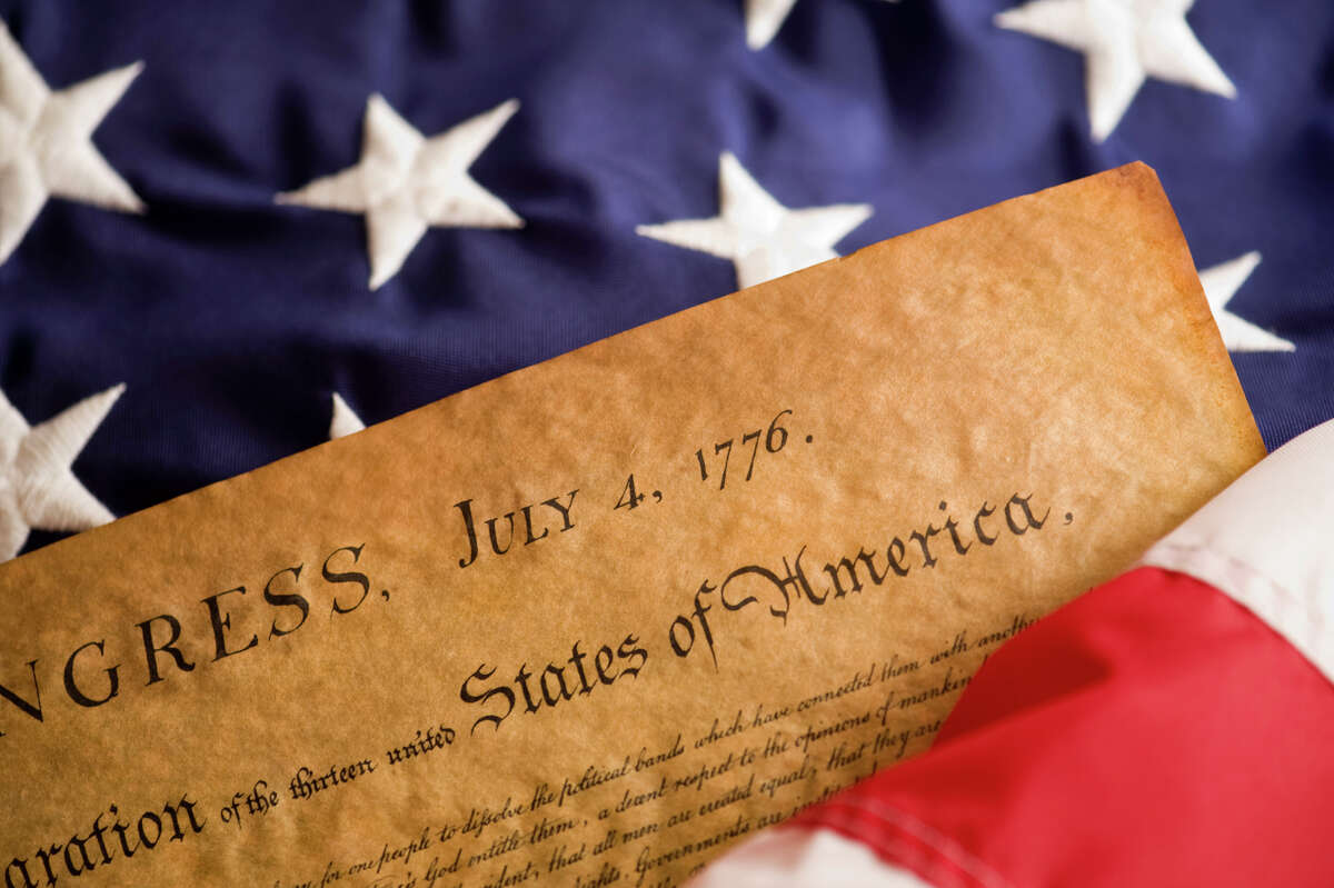 The Declaration of Independence and American Flag. (Getty Images)
