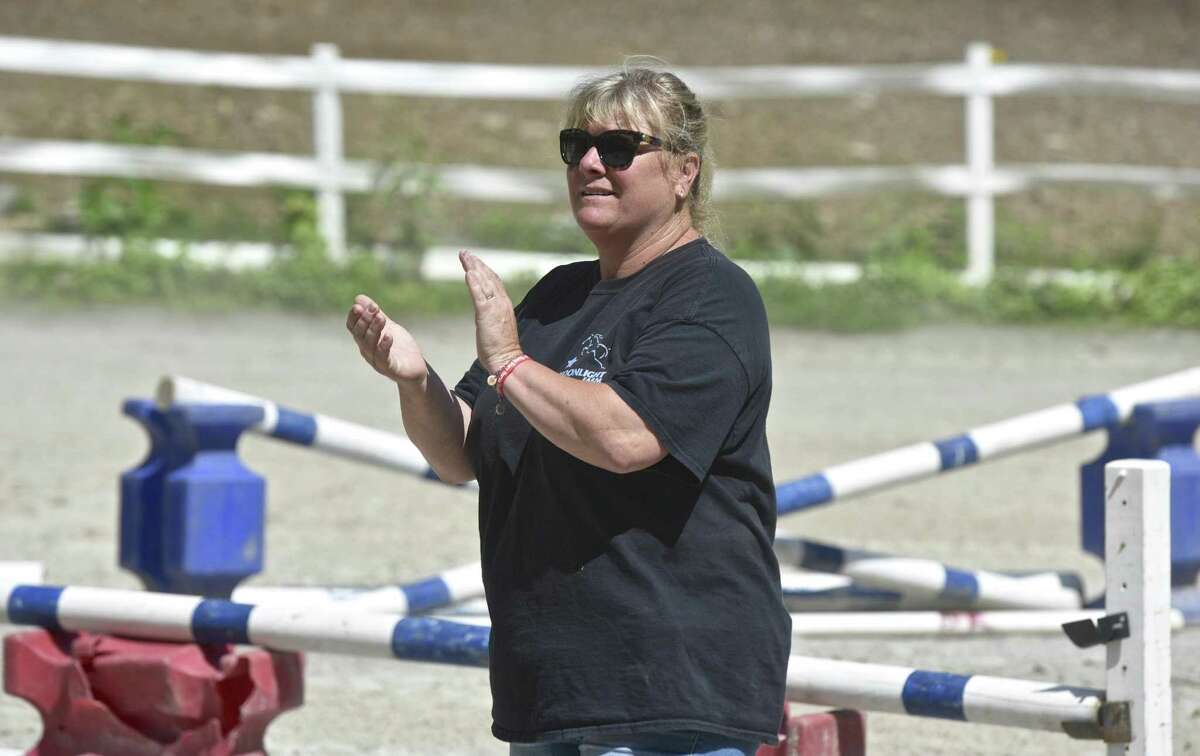 Kelly Stackpole, of Moonlight Farms, in Redding, works with riders during summer camp. Stackpole also is running Rising Starr Horse Rescue which rescues horses and helps children, teens and adults develop self confidence though riding. Monday, July 3, 2017, in Redding, Conn.