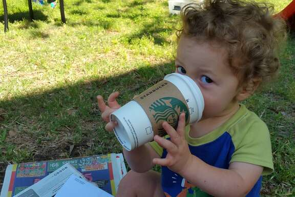 "Milo pretends to drink coffee like his daddy, who he calls ""Mama."""