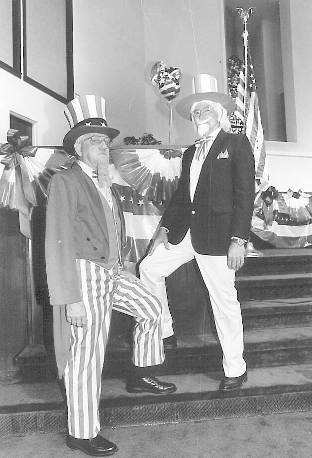 Norman Ener and James Galliger, both members of North End Baptist Church pose in their Uncle Sam costumes Sunday inthe sanctuary of the church. Photo taken july 4, 1993. Photo: Enterprise File Photo