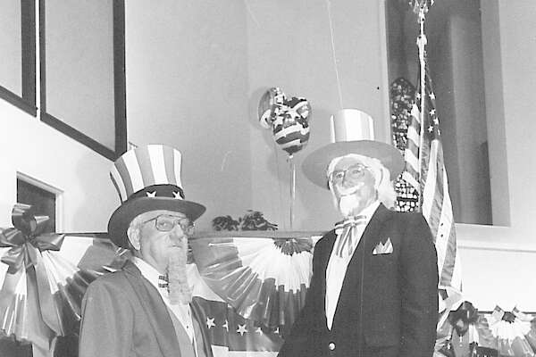 Norman Ener and James Galliger, both members of North End Baptist Church pose in their Uncle Sam costumes Sunday inthe sanctuary of the church. Photo taken july 4, 1993.