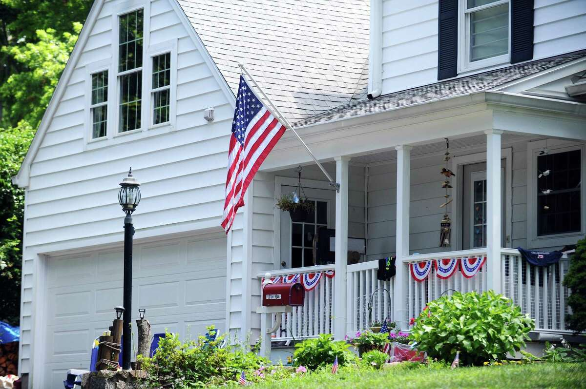 A house on Tower Avenue displays an American flag in Stamford, Conn. on Sunday, July 2, 2017.