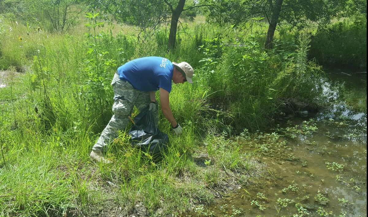 Volunteershelped clean upareas near the Ventura subdivision ponds on July 1, The area is off Walzem Road, just south of Elm Trail.