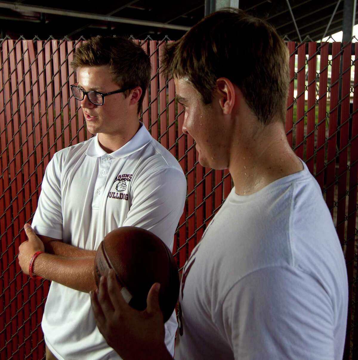 Magnolia punter Reid Bauer, left, talks about expectations for the upcoming season along side snapper Justin Mader during a portrait session at Magnolia High School, Thursday, June 29, 2017, in Magnolia.
