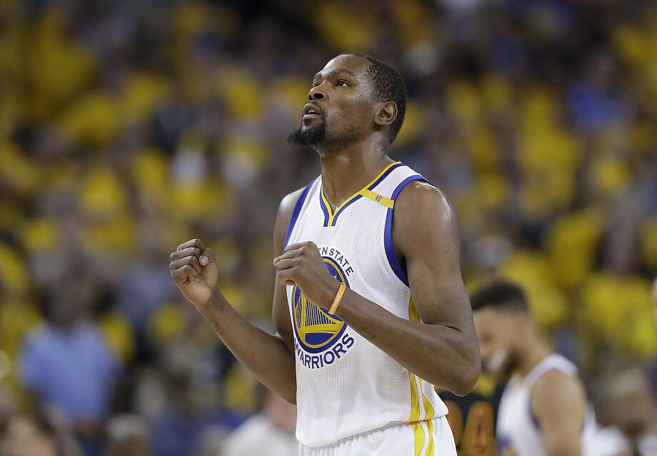 FILE - In this June 12, 2017 file photo, Golden State Warriors forward Kevin Durant reacts after scoring against the Cleveland Cavaliers during the second half of Game 5 of basketball's NBA Finals in Oakland, Calif. A person with knowledge of the situation tells The Associated Press that Durant has agreed to terms on a two-year deal worth about $53 million to remain with the Golden State Warriors. The deal calls for about $25 million in the first year with a player option for the second season. The person spoke on condition of anonymity because the contract cannot be signed until Thursday, July 6, 2017. (AP Photo/Marcio Jose Sanchez, File) Photo: Marcio Jose Sanchez, Associated Press