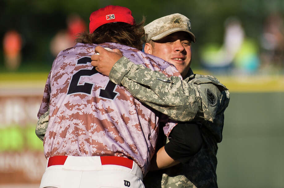 Sgt. Steven Braley hugs Great Lakes Loons pitcher Vinny Santarsiero before the Loons take on the West Michigan Whitecaps on Monday, July 3, 2017 at Dow Diamond. Photo: (Katy Kildee/kkildee@mdn.net)