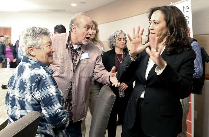 Eva Bruce (left) and Richard Dturri (middle) talk with Senator Kamala Harris as she visits the Institute on Aging to talk to the elderly and their caretakers about health care bills' potential effects on the elderly on Monday, July 3, 2017, in San Francisco, Calif.