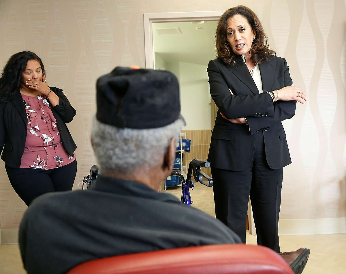Senator Kamala Harris (right) talks with Clem McCoy (middle), 83 years old, as she visits the Institute on Aging to talk to the elderly and their caretakers about health care bills' potential effects on the elderly on Monday, July 3, 2017, in San Francisco, Calif.