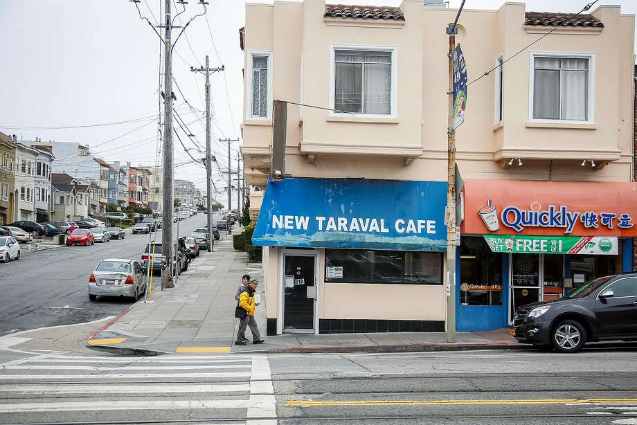 People walk past the the New Traval Cafe on Taraval Street in San Francisco on Saturday, July 1, 2017. Photo: Nicole Boliaux, The Chronicle