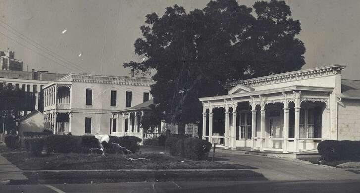 """View looking north along Alamo Street. (right to left): Boelhauwe House a and b, two-story Flannery House and Beversdorf House (on the far end). The two-story Flannery House, at 309 North Alamo Street, is still standing. The tiny Beversdorff House remains next door, at 305 North Alamo Street, and is thought to be a part of the original """"Irish Flats."""" The Boelhauwe Houses were demolished in 1968."""