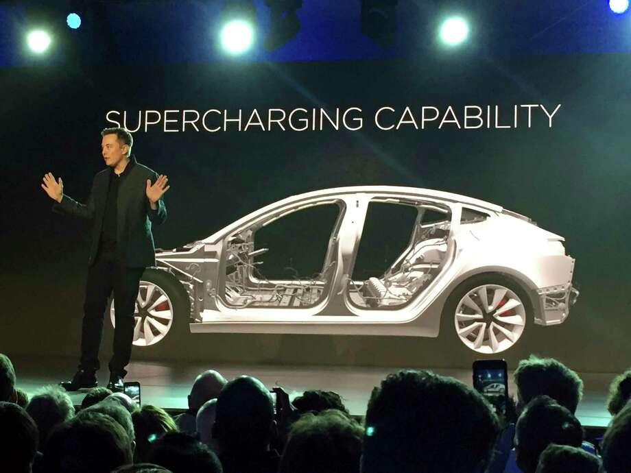 Tesla Motors Inc. CEO Elon Musk speaks at the unveiling of the Model 3 at the Tesla Motors design studio in Hawthorne, Calif. Photo: Justin Pritchard, STF / Copyright 2017 The Associated Press. All rights reserved.