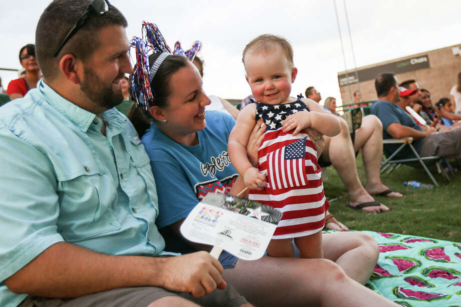 Conroe residents Aaron and Hailey Miears introduce their daughter Claire, 1, to classical music during the Star Spangled Salute by the Houston Symphony on Monday at Cynthia Woods Mitchell Pavilion. Photo: Michael Minasi, Staff Photographer / © 2017 Houston Chronicle