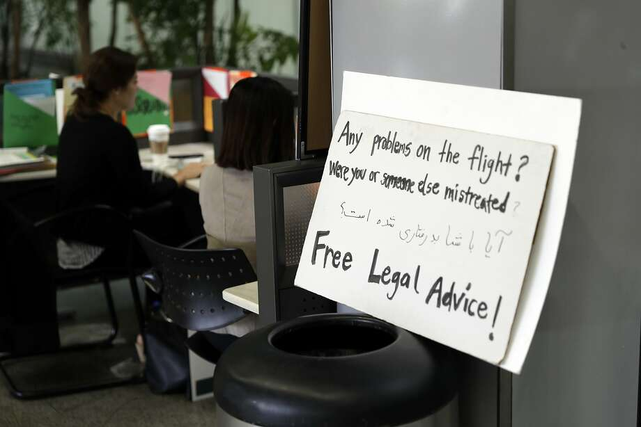 Free legal advice is offered in the international terminal at San Francisco International Airport, Friday, June 30, 2017, in San Francisco. A scaled-back version of President Donald Trump's travel ban took effect Thursday, stripped of provisions that brought protests and chaos at airports worldwide in January yet still likely to generate a new round of court fights. (AP Photo/Marcio Jose Sanchez) Photo: Marcio Jose Sanchez, Associated Press