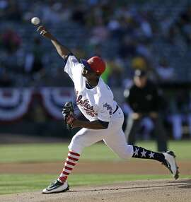 Oakland Athletics pitcher Jharel Cotton works against the Chicago White Sox in the first inning of a baseball game Monday, July 3, 2017, in Oakland, Calif. (AP Photo/Ben Margot)
