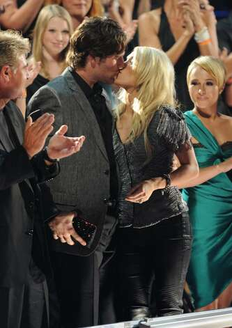 NASHVILLE, TN - JUNE 09:  Mike Fisher kisses Carrie Underwood after she wins an award at the 2010 CMT Music Awards at the Bridgestone Arena on June 9, 2010 in Nashville, Tennessee.  (Photo by Jason Merritt/Getty Images) *** Local Caption *** Mike Fisher;Carrie Underwood Photo: Jason Merritt, Getty Images / 2010 Getty Images