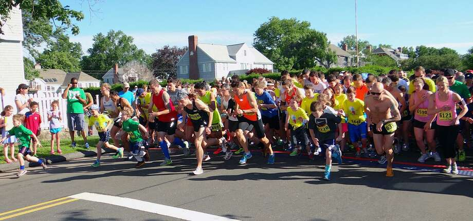 Runners step off the starting line on Fairfield Beach Road for the Stratton Faxon 5K Road Race in June. Photo: Mike Lauterborn / Mike Lauterborn / Fairfield Citizen