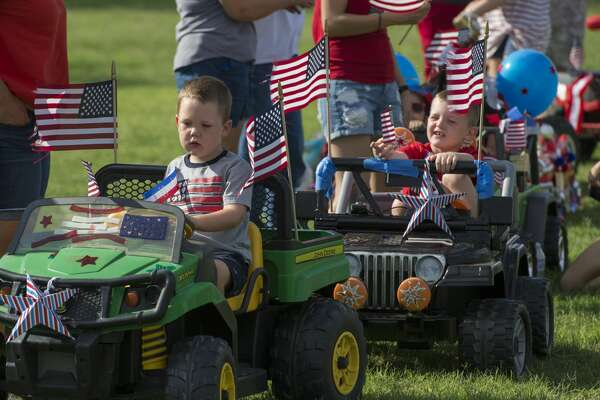 Children and adults line the roadway through Hogan Park for the 55th annual Children's Parade 7/04/17. Tim Fischer/Reporter-Telegram