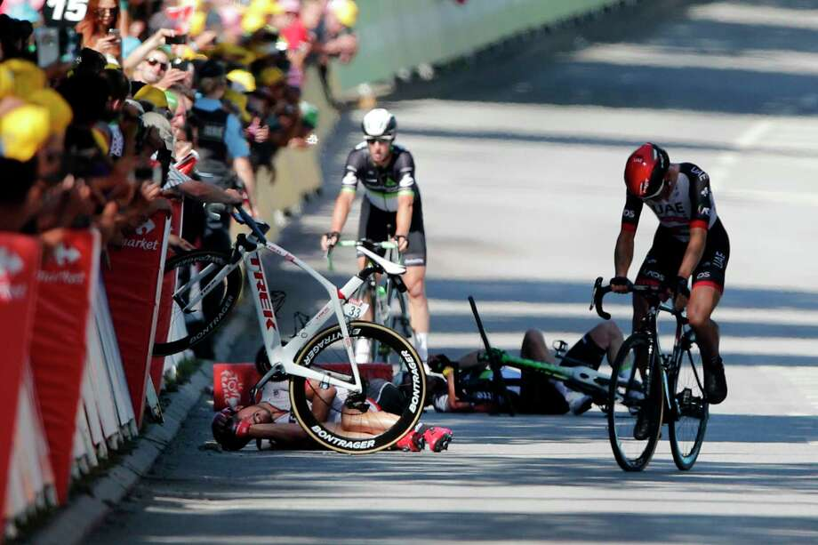 Germany's John Degenkolb, left, and Britain's Mark Cavendish crash during the sprint of the fourth stage of the Tour de France cycling race over 207.5 kilometers (129 miles) with start in Mondorf-les-Bains, Luxembourg, and finish in Vittel, France, Tuesday, July 4, 2017. Photo: Christophe Ena, AP / Copyright 2017 The Associated Press. All rights reserved.