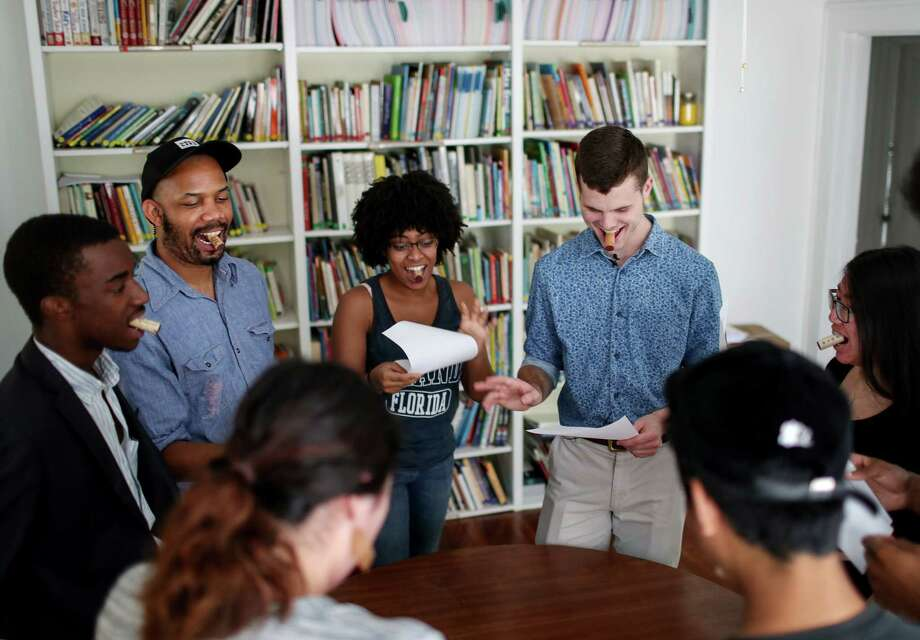 Donald Val, from left, instructor Emanuellee Bean, Ashlyn Stewart, Jackson Neal and Alinda Mac do a voice warm-up exercise during a practice session for young slam poets. Photo: Jon Shapley, Houston Chronicle / © 2017 Houston Chronicle