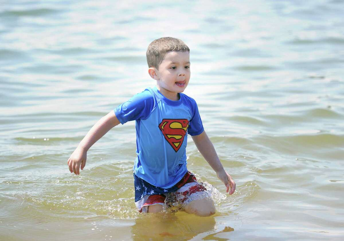 Jordan Byxbee, 4, of Stamford, wore a Superman T-shirt while playing in Long Island Sound on the Fourth of July at Cummings Park beach in Stamford, Conn., Tuesday, July 4, 2017.
