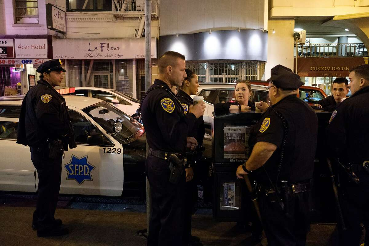 July 3, 2017 - Officers of the Tenderloin Station have a coffee and catch up prior to starting their late night shifts. This group of officers chipped in $10 and $20 piece the other night to get a homeless woman and her 2-year-old daughter housing at a TL hotel after every shelter the cops contacted turned them away.. (Nick Otto Special to the Chronicle)
