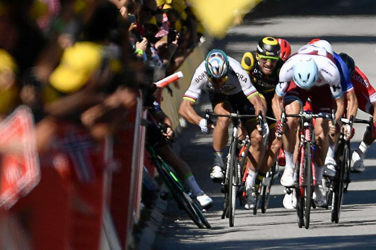 Slovakia's Peter Sagan (2ndL) gives a kick of elbow and Great Britain's Mark Cavendish (L) falls near the finish line at the end of the 207,5 km fourth stage of the 104th edition of the Tour de France cycling race on July 4, 2017 between Mondorf-les-Bains and Vittel. / AFP PHOTO / Jeff PACHOUDJEFF PACHOUD/AFP/Getty Images