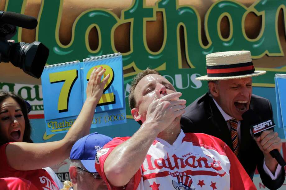 Joey Chestnut eats two hot dogs at a time during the Nathan's Annual Famous International Hot Dog Eating Contest, Tuesday July 4, 2017, in New York. Chestnut won, marking his 10th victory in the event. (AP Photo/Bebeto Matthews) ORG XMIT: NYBM116 Photo: Bebeto Matthews / Copyright 2017 The Associated Press. All rights reserved.