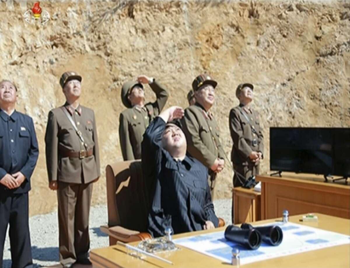 This image made from video of a news bulletin aired by North Korea's KRT on Tuesday, July 4, 2017, shows what was said to be North Korea leader Kim Jung Un, center, watching the launch of a Hwasong-14 intercontinental ballistic missile, ICBM, in North Korea's northwest. Independent journalists were not given access to cover the event depicted in this photo. North Korea claimed to have tested its first intercontinental ballistic missile in a launch Tuesday, a potential game-changing development in its push to militarily challenge Washington � but a declaration that conflicts with earlier South Korean and U.S. assessments that it had an intermediate range. (KRT via AP Video)