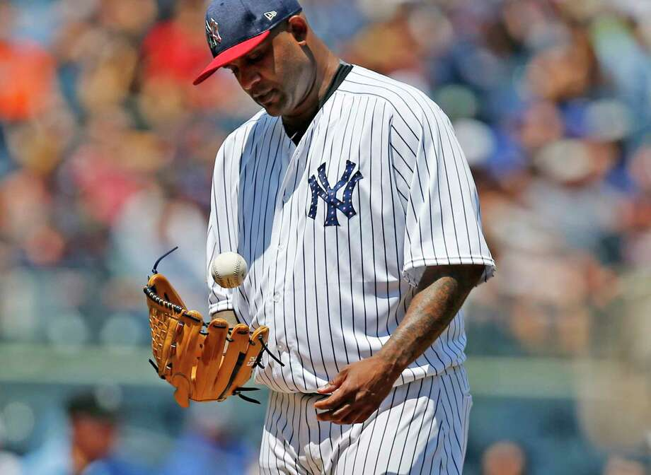 New York Yankees starting pitcher CC Sabathia tosses the ball up after allowing a two-run single to Toronto Blue Jays'  Kendrys Morales during the third inning of a baseball game in New York, Tuesday, July 4, 2017. Yankees manager Joe Girardi removed Sabathia after he allowed four runs in two and two-thirds innings. (AP Photo/Kathy Willens) ORG XMIT: NYY106 Photo: Kathy Willens / Copyright 2017 The Associated Press. All rights reserved.