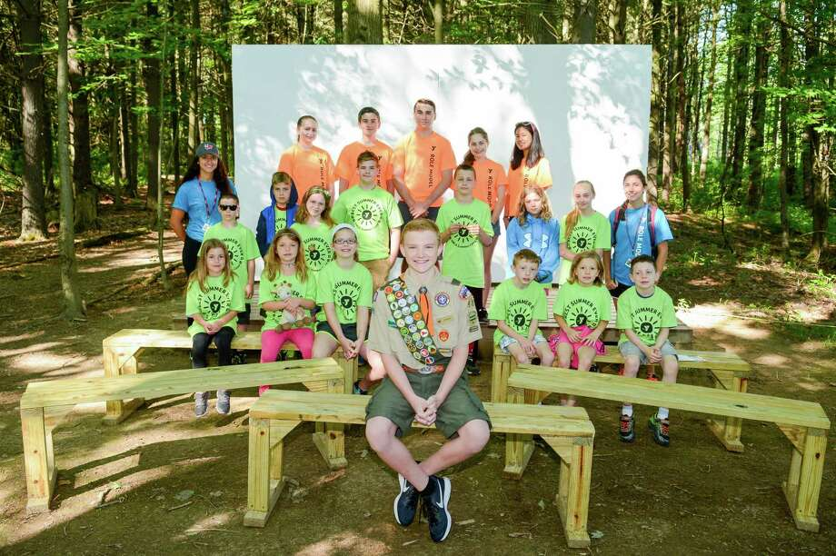 Kids at the Bethlehem YMCA summer camp are enjoying a new, expanded stage for skits and songs, as well as 13 new benches.  Jeffrey Hansen of Boy Scout Troop 58 in Delmar, designed and built the stage and benches for his Eagle Scout project, with the assistance of other scouts in the troop. (Submitted photo) Photo: Mark L. Emerson / EMERSONPHOTOGRAPHY