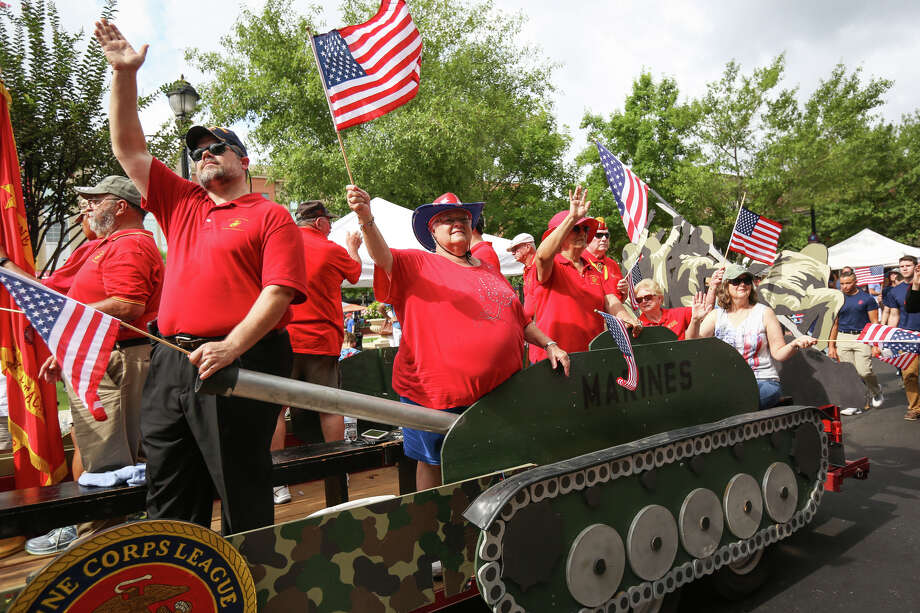 Members of the Eastex Detachment Marine Corps League wave to attendees of the South County Fourth of July Parade on Tuesday at Market Street in The Woodlands. Photo: Michael Minasi, Staff Photographer / © 2017 Houston Chronicle