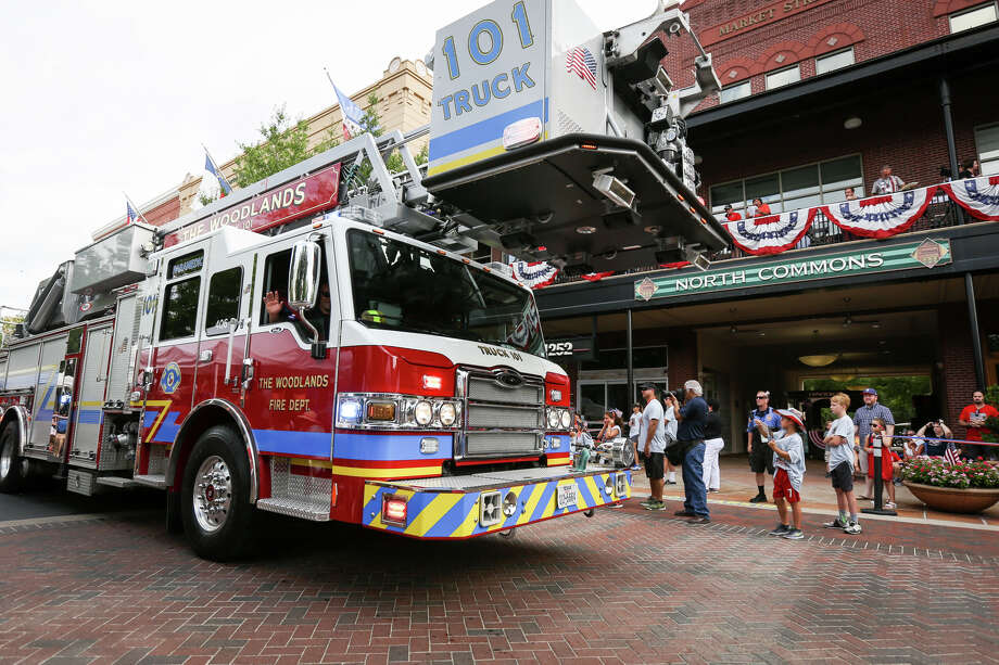 The Woodlands Fire Department takes part in the South County Fourth of July Parade on Tuesday at Market Street in The Woodlands. Photo: Michael Minasi, Staff Photographer / © 2017 Houston Chronicle