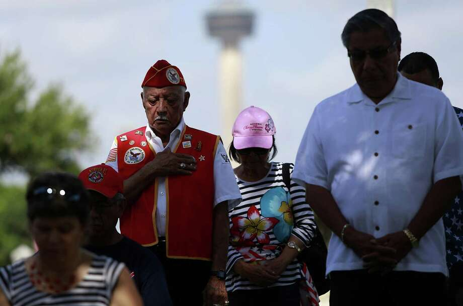 Vietnam veteran, Raul Juarez, 86, hand on his heart and head bowed down in respect stands as Ret. Lt. Col. Vincent Carr (not photographed) sings the national anthem. Photo: Srijita Chattopadhyay, Staff / San Antonio Express-News / © 2017 San Antonio Express-News