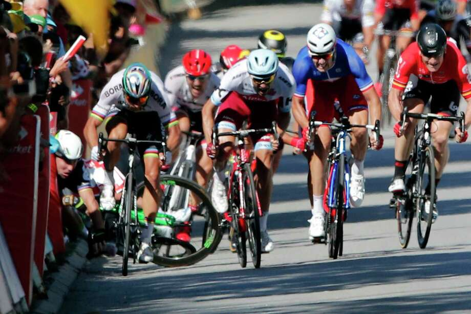 Britain's Mark Cavendish crashes during the sprint of the fourth stage of the Tour de France cycling race over 207.5 kilometers (129 miles) with start in Mondorf-les-Bains, Luxembourg, and finish in Vittel, France, , Tuesday, July 4, 2017. (AP Photo/Christophe Ena) ORG XMIT: ENA143 Photo: Christophe Ena / Copyright 2017 The Associated Press. All rights reserved.