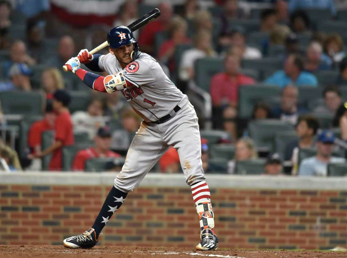 Houston Astros Carlos Correa avoids a close pitch during the fifth inning of a baseball game against the Atlanta Braves, Tuesday, July 4, 2017, in Atlanta. (AP Photo/Richard Hamm)
