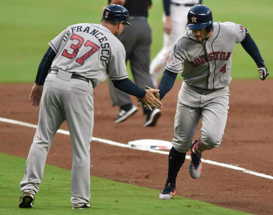 Houston Astros' George Springer celebrates a run with Astros Triple-A manager Tony DeFrancesco during the third inning of a baseball game against the Atlanta Braves, Tuesday, July 4, 2017, in Atlanta. (AP Photo/Richard Hamm) Photo: Richard Hamm, Associated Press / AP