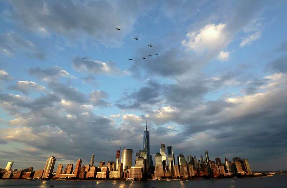 Police helicopters fly in formation over the Hudson River with the New York City skyline seen below prior to the Jersey City Fourth of July fireworks celebration, Tuesday, July 4, 2017, seen from Jersey City, N.J. (AP Photo/Julio Cortez) ORG XMIT: NJJC101 Photo: Julio Cortez / Copyright 2017 The Associated Press. All rights reserved.
