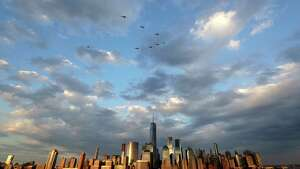 Police helicopters fly in formation over the Hudson River with the New York City skyline seen below prior to the Jersey City Fourth of July fireworks celebration, Tuesday, July 4, 2017, seen from Jersey City, N.J. (AP Photo/Julio Cortez) ORG XMIT: NJJC101