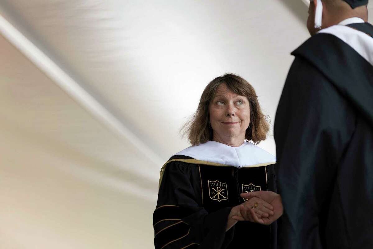 Jill Abramson, former executive editor of 2014 YEAR IN REVIEW - FOR USE AS DESIRED -- The New York Times, shakes hands with a graduate during a graduation ceremony at Wake Forest University in Winston Salem, N.C., May 19, 2014. Abramson made her first public appearance since her abrupt dismissal last week, speaking about resilience in a long-scheduled commencement address on Monday. (Jeremy M. Lange/The New York Times) ORG XMIT: NYT258