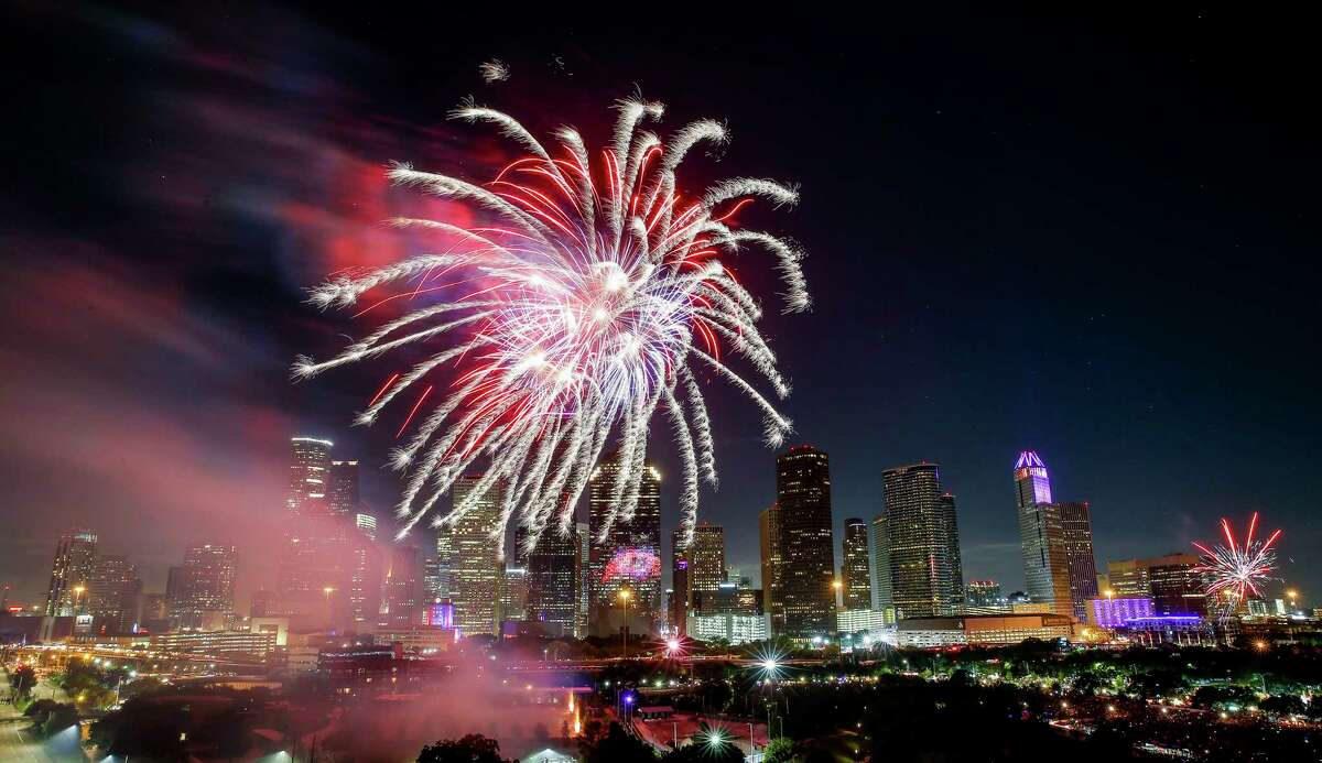 Fireworks shoot off in front of the Houston skyline for the Freedom over Texas Fireworks Spectacular Tuesday, July 4, 2017 in Houston.