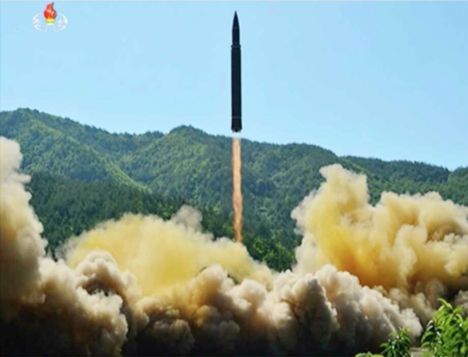 This image made from video of a news bulletin aired by North Korea's KRT on Tuesday, July 4, 2017, shows what was said to be the launch of a Hwasong-14 intercontinental ballistic missile, ICBM, in North Korea's northwest. Independent journalists were not given access to cover the event depicted in this photo. North Korea claimed to have tested its first intercontinental ballistic missile in a launch Tuesday, a potential game-changing development in its push to militarily challenge Washington — but a declaration that conflicts with earlier South Korean and U.S. assessments that it had an intermediate range. (KRT via AP Video) ORG XMIT: BKWS103 / KRT