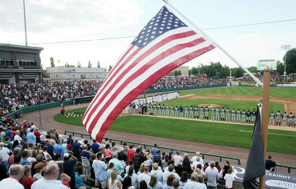 Fans stand during the national anthem as the Tri-City ValleyCats play the Brooklyn Cyclones during a minor league baseball game on Tuesday, July 4, 2017, in Troy, N.Y. (Hans Pennink / Special to the Times Union) ORG XMIT: HP105