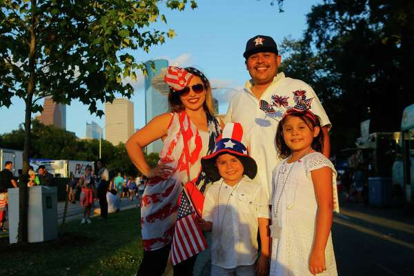 Houstonians celebrate at the CITGO Freedom Over Texas Independence Day celebration along the Buffalo Bayou, Tuesday, July 4, 2017.