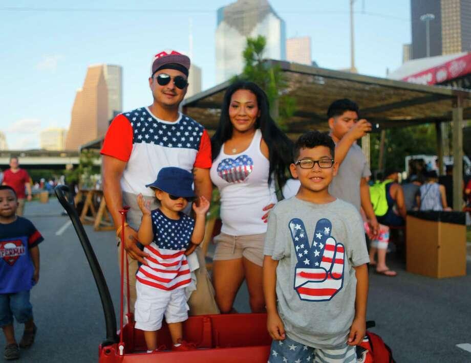 Houstonians celebrate at the CITGO Freedom Over Texas Independence Day celebration along the Buffalo Bayou, Tuesday, July 4, 2017. Photo: Mark Mulligan, Mark Mulligan / Houston Chronicle / 2017 Mark Mulligan / Houston Chronicle
