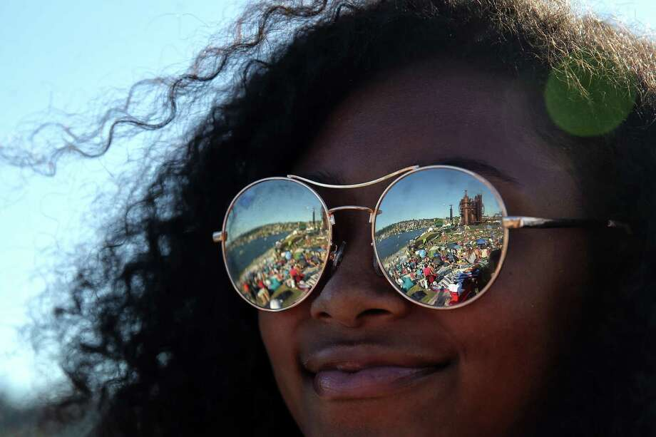 Gas Works Park is reflected in the sunglasses of Xavia Baird during Fourth of July celebrations, Tuesday, July 4, 2017. Photo: GENNA MARTIN, SEATTLEPI.COM / SEATTLEPI.COM