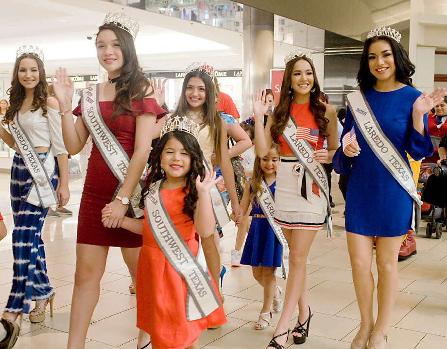 Beauty Queens march their way through a children's 4th of July parade hosted by the Imaginarium of South Texas at Mall Del Norte on Tuesday afternoon. Photo: Francisco Vero
