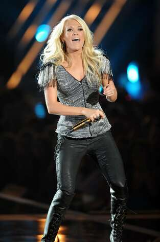 NASHVILLE, TN - JUNE 09:  Carrie Underwood performs onstage at the 2010 CMT Music Awards at the Bridgestone Arena on June 9, 2010 in Nashville, Tennessee.  (Photo by Jason Merritt/Getty Images) *** Local Caption *** Carrie Underwood Photo: Jason Merritt, Getty Images / 2010 Getty Images
