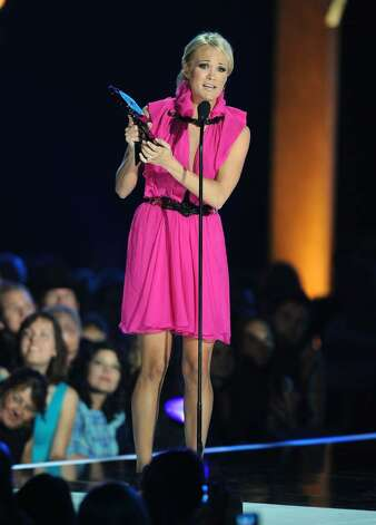 NASHVILLE, TN - JUNE 09:  Singer Carrie Underwood accepts her award for CMT Performance of the Year onstage at the 2010 CMT Music Awards at the Bridgestone Arena on June 9, 2010 in Nashville, Tennessee.  (Photo by Jason Merritt/Getty Images) *** Local Caption *** Carrie Underwood Photo: Jason Merritt, Getty Images / 2010 Getty Images
