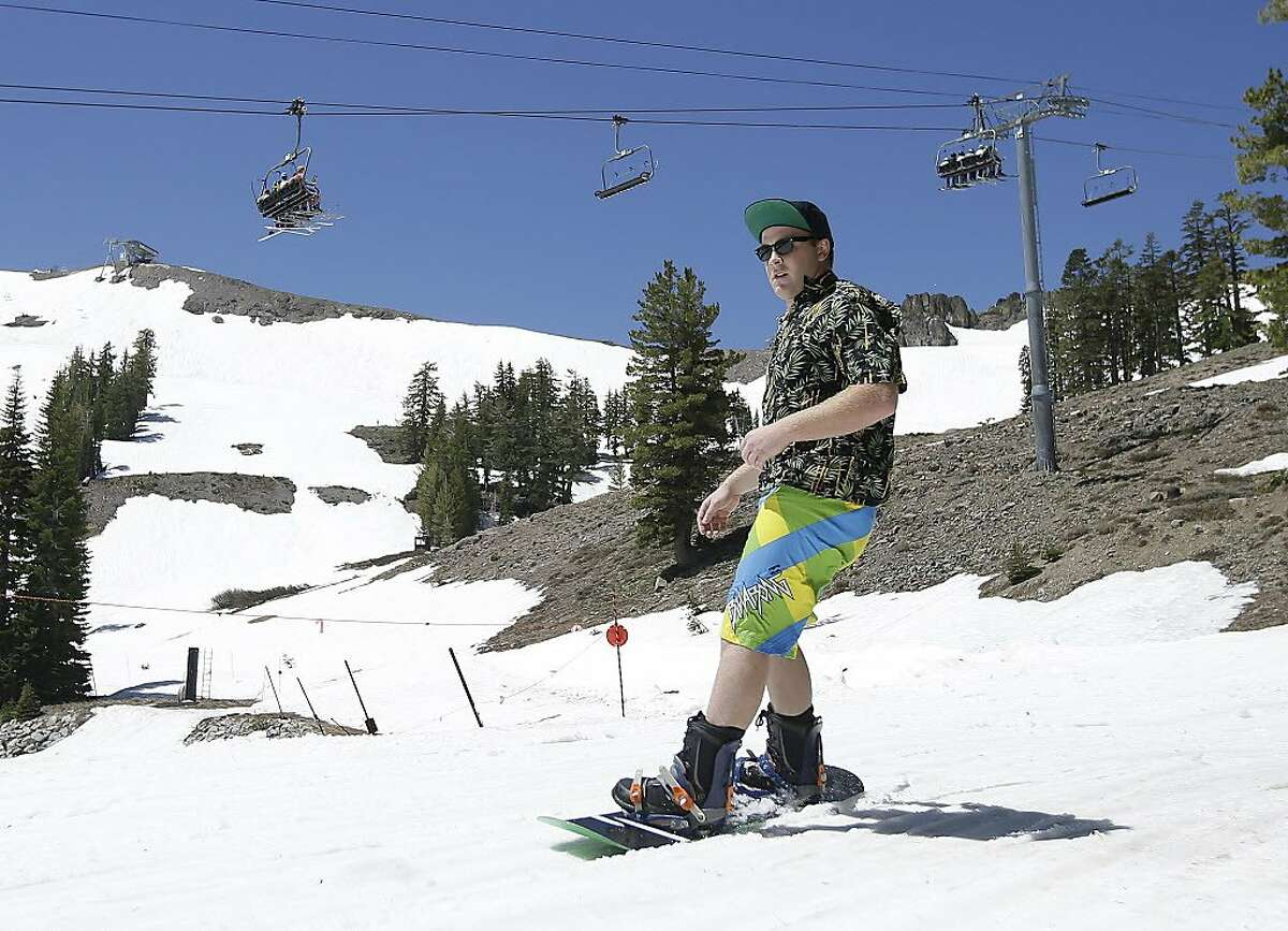 Shorts and a short sleeve shirt were the attire for this snow boarder at Squaw Valley Ski Resort, Saturday, July 1, 2017, in Squaw Valley, Calif. With snow still deep enough for skiing at the higher elevations, Squaw Valley is expected to be open through the 4th of July, only the fourth time the resort has been open for skiing in July. (AP Photo/Rich Pedroncelli)