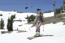 Shorts and a tank top were the attire for this skier at Squaw Valley Ski Resort, Saturday, July 1, 2017, in Squaw Valley, Calif. Because of this years heavy snow fall Squaw Valley is expected to be open through the 4th of July, only the fourth time the resort has been open for skiing in July. (AP Photo/Rich Pedroncelli)